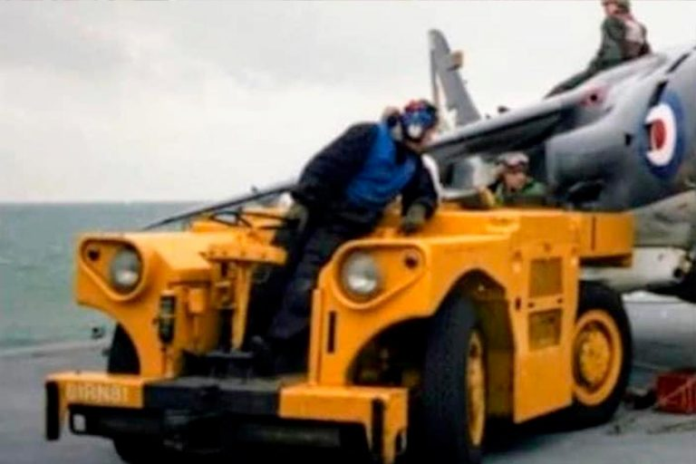 Aircraft towing tractor preparing Harrier in 1982